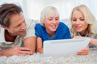 Son and his parents using a tablet