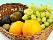 orange, kiwi and grape in basket