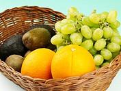 orange, kiwi and grape in basket
