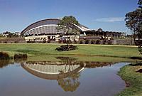 SYDNEY OLYMPICS, HOMEBUSH BAY, SYDNEY, AUSTRALIA, EQUUS 2000.SCOTT CARVER TIM COURT&CO/SJPH DESIGN, EXTERIOR, NORTH EAST FACADE WITH POND.