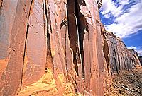 Rock climbing a route called Electronic Battleship which is rated 5,10 and located in Long Canyon near the town of Moab in southern Utah.