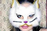 young woman wearing a cats mask  - 18/12/2007