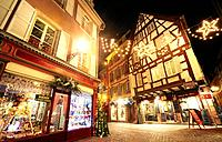 Typical timber-framing houses witn Christmas lights at the city center by night. Colmar. Wine route. Haut-Rhin. Alsace. France.