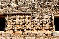 MEXICO, MERIDA, KABAH, 23.03.2009, Maya ruin of Kabah, temple of the Masks, the façade decorated with hundreds of stone masks of the long-nosed rain g...