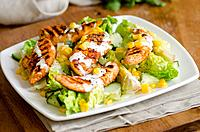 Griddled chicken, lettuce and corn on the cob salad.