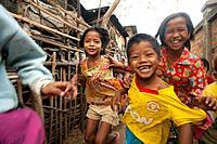 Young children run through a small village near Battambang, Cambodia.