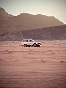 Off road vehicle in the desert at sunset, Wadi Rum, Jordan, Middle East, Asia