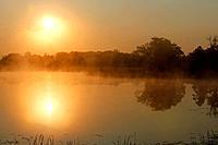 Sunrise, autumn fog over Big Rock Lake near Detroit Lakes, Minnesota, USA