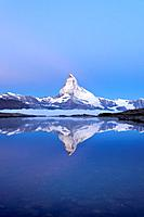 Mt Matterhorn reflected in Stellisee Lake at dusk, Zermatt, Canton of Valais, Switzerland