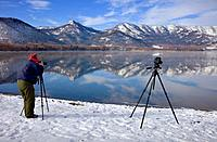 Photographer in Lake Kussharo,Akan National Park,Hokkaido,Japan.