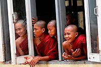 Novices looking out of a window, Burma.