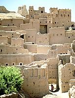 Ait Ben Haddou - the original approach and entrance. A striking example of a ksar, a fortified city composed of earthen buildings surrounded by high d...
