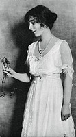 Lady Elizabeth Bowes-Lyon with a red carnation, 1923, (1937). The future Queen Mother (1900-2002). A print from the Illustrated London News: Coronatio...