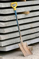 Spade resting against concrete