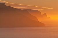 Evening glow at the northwest coast of Majorca. Banyalbufar area and Dragonera isle silhouette at sunset. Balearic islands, Spain