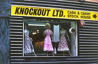 Dresses on display in the shop window of 'Knockout' cash and carry stock house. By the looks of the clothes for sale 'Frock Horror' would be a more ap...