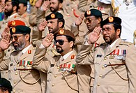 Military chiefs in uniform, with medals, saluting parade of armed forces in Abu Dhabi, United Arab Emirates