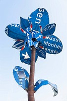 Germany, Munich, flower sculpture, old traffic signs during Tollwood Festifal