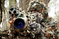 German nature documentary maker Hans Schweiger at work, well camouflaged. Oklahoma, USA