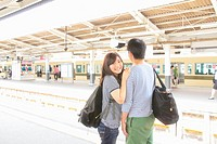 Young couple on platform at train station