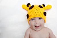 Baby girl in giraffe hat.