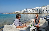 Greece Paros Cyclades Naousa or Naouusa relax couple with drinks near water 6.