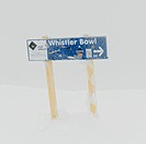 Directional sign in snow, Whistler Mountain, Whistler, British Columbia, Canada