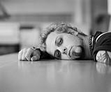 Portrait of male punk rocker with head on table