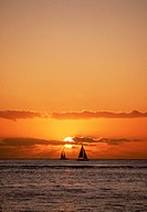 Sailboat on water at sunset
