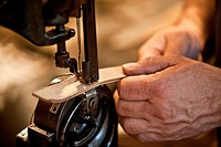 Saddler at work, close-up