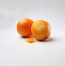 Two Oranges,One with Part of The Peel grated