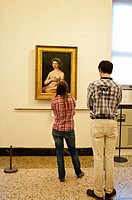 Two visitors in front of 'Portrait of a Young Woman', or 'La fornarina' by Raphael, Palazzo Barberini, Rome, Italy.