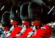 Scots Guards at the Changing of the Guard ceremony at Buckingham Palace in London, England, on a sunny Summer morning.