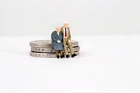 Two old people sitting on EUR Coins - , GERMANY, 12/05/2013