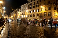 Crowded Roman street at night