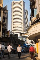 People on a side street near the Bombay Stock Exchange.
