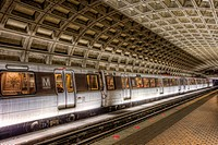 A subway train prepares to depart the Farragut West station of the Washington DC metro headed for Vienna.