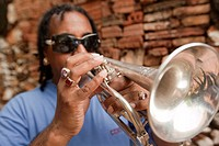 Cuban musician playing trumpet, Trinidad, Cuba, Antilles, Central America.