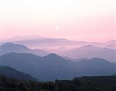 Silhouetted mountain range at sunset