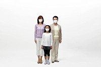 Multi_generational female family wearing surgical masks