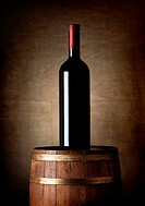 Bottle of wine on an old barrel.