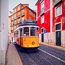 Traditional Yellow Tram on the street of Lisbon, Portugal.