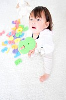 Baby girl holding number toy