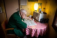 ILLUSTRATION OF AGEING AT HOME, ELDERLY PERSON AT HOME READING THE NEWSPAPER