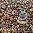 Wet pebbles and a small cairn of larger wet stones on a Buckie Beach, Scotland