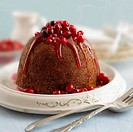 Cranberry pudding with fruit sauce
