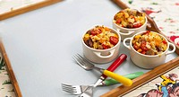 Fusilli with vegetables and slices of sausage for children