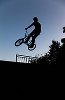 athlete doing bmx trick