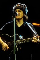Italian singer-songwriter and musician Zucchero (Adelmo Fornaciari) performing at State Kremlin Palace wearing a shapka decorated with hammer and sick...