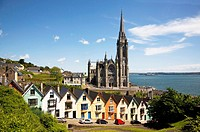 Terrace of Colourful Georgian Houses below St Colman´s Cathedral, Cobh, Great Island, County Cork, Ireland.